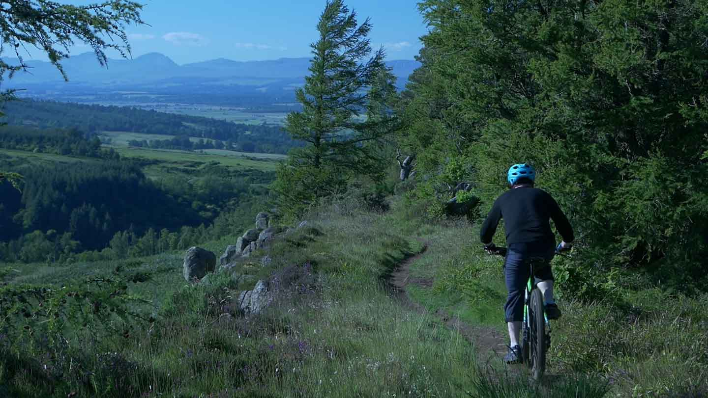View of Southern Highlands with Mountain biker in foreground